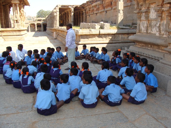 Students learning practical history inside Vittala complex at Hampi by Vikram Roy © Copyright 2012